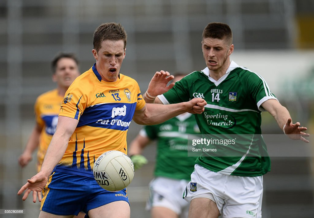 Limerick , Ireland - 29 May 2016; Eoin Cleary of Clare in action against Danny Neville of Limerick during the Munster GAA Football Senior Championship quarter-final between Limerick and Clare at Gaelic Grounds in Limerick.