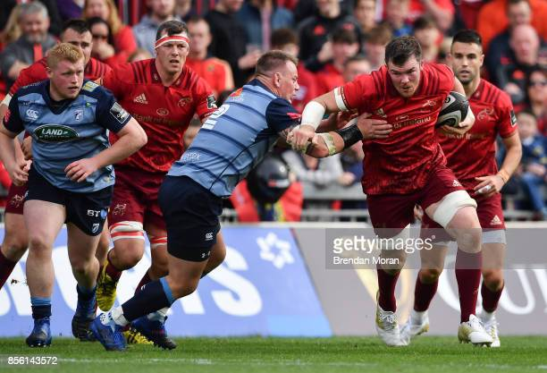 Limerick Ireland 30 September 2017 Peter OMahony of Munster is tackled by Matthew Rees of Cardiff Blues during the Guinness PRO14 Round 5 match...