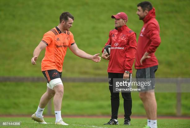 Limerick Ireland 4 October 2017 Peter O'Mahony of Munster in conversation with defence coach Jacques Nienaber during Munster Rugby Squad Training at...