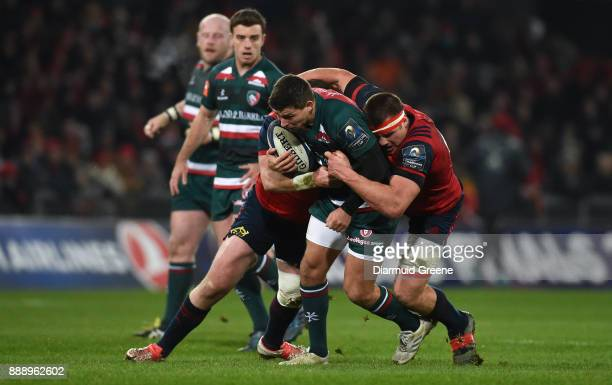 Limerick Ireland 9 December 2017 Ben Youngs of Leicester Tigers is tackled by Dave Kilcoyne left and CJ Stander of Munster during the European Rugby...