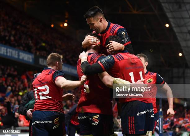 Limerick Ireland 9 December 2017 Peter O'Mahony is congratulated by his Munster teammates including Conor Murray top after scoring his side's third...
