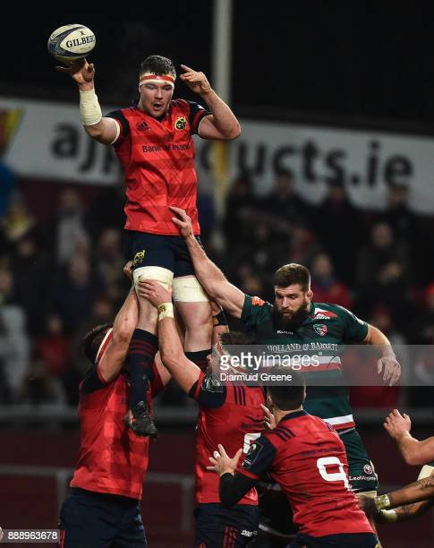 Limerick Ireland 9 December 2017 Peter O'Mahony of Munster wins possession in a lineout ahead of Michael Fitzgerald of Leicester Tigers during the...