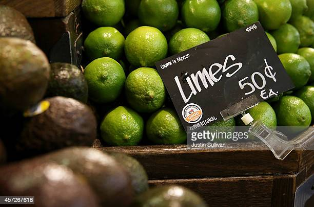 Limes are displayed with a 'good' rating at a Whole Foods market on October 15 2014 in San Francisco California Upscale grocery chain Whole Foods...
