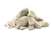 Stone and dust (limestone) isolated on a white background.