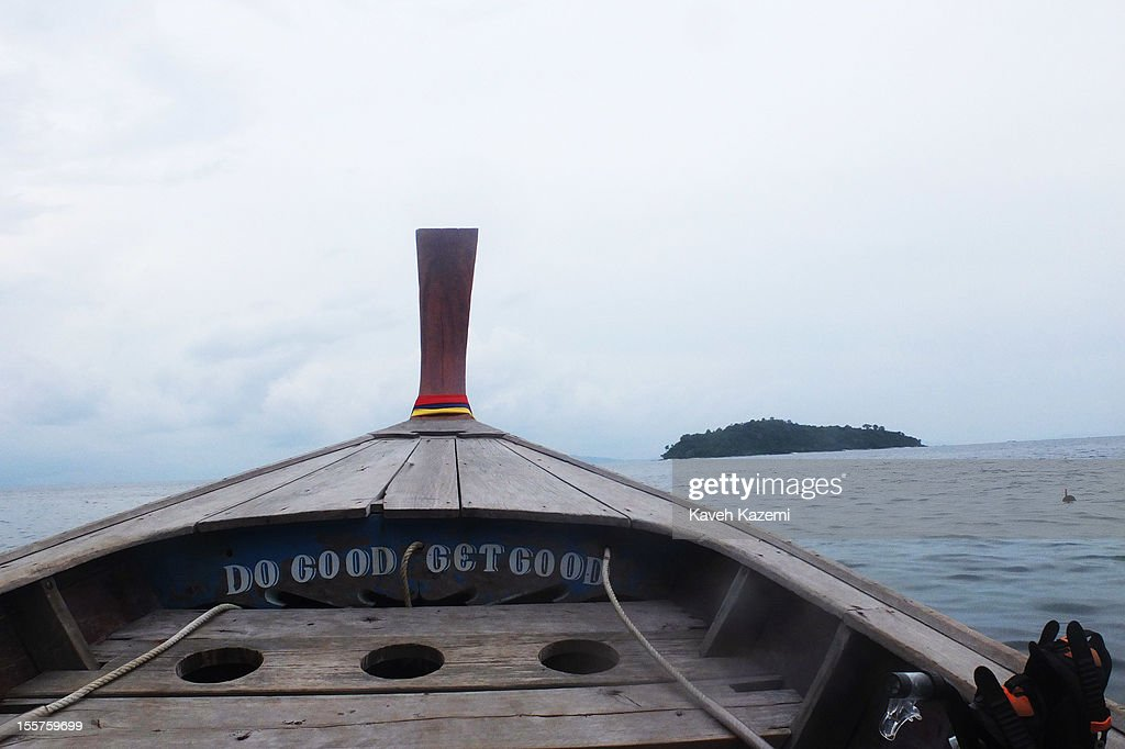 Limestone mountains appear in the background where a gypsy boat is at sea on for a snorkeling trip on October 22 in Koh Phi Phi Don, Thailand.