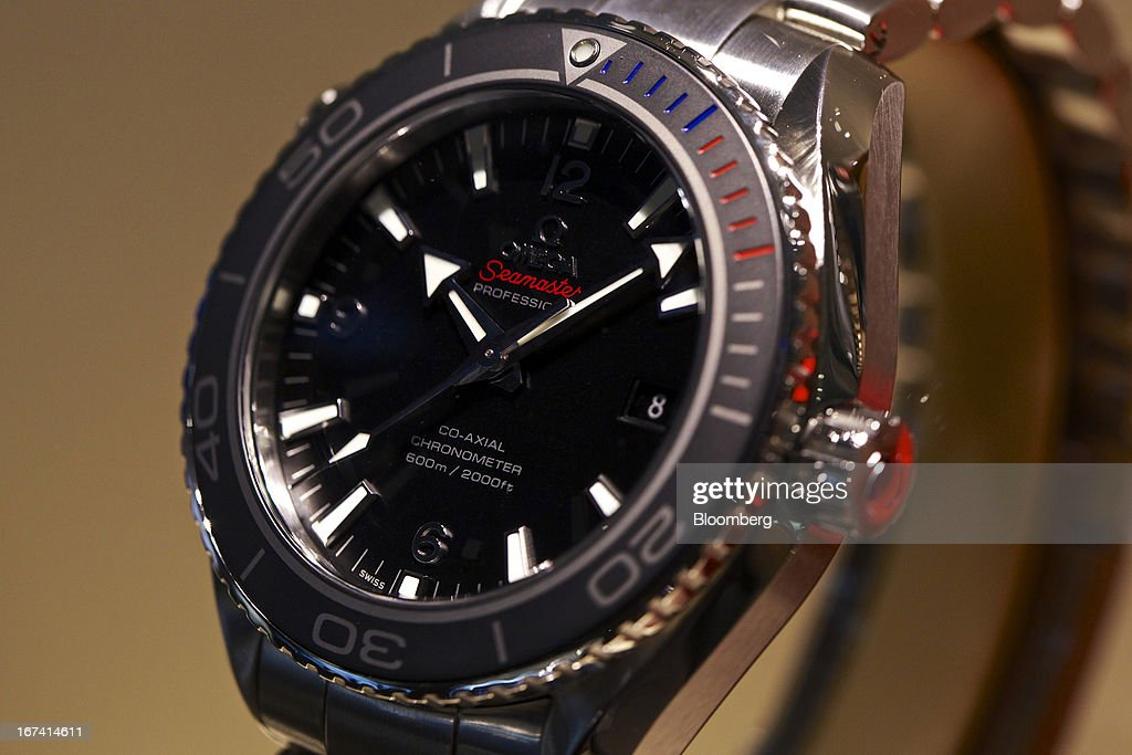 A limited edition Olympic 'Sochi 2014' Seamaster Professional wristwatch, manufactured by Omega, a unit of Swatch Group AG, and made for the 2014 Olympic games, sits on display during the Baselworld watch fair in Basel, Switzerland, on Wednesday, April 24, 2013. The annual fair attracts 2,000 companies from the watch, jewelry and gem industries to show their new wares to more than 100,000 visitors. Photographer: Gianluca Colla/Bloomberg via Getty Images