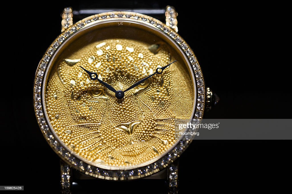 A limited edition Rotonde Panther watch sits on display at the Cartier, a unit of Cie. Financiere Richemont SA, booth on the first day of the Salon International de la Haute Horlogerie (SIHH) watch fair in Geneva, Switzerland, on Monday, Jan. 21, 2013. The Swiss watch industry slowed in the second half of 2012 as sales of timepieces and jewelry in Hong Kong, the biggest market for Swiss watchmakers, declined in August and October. Photographer: Valentin Flauraud/Bloomberg via Getty Images