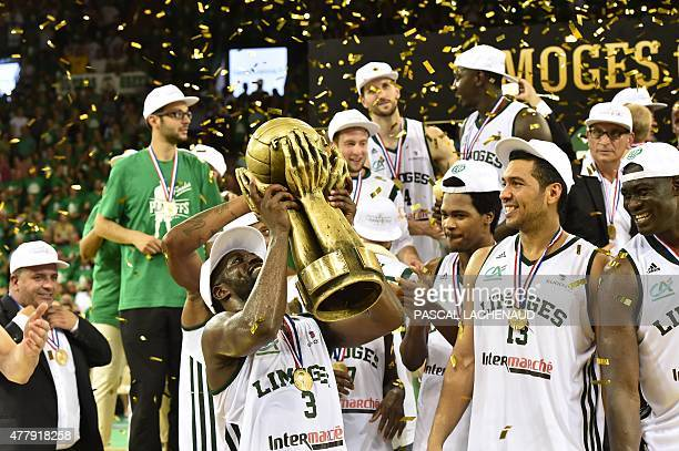 Limoges' Eugene Jeter lifts the trophy as players celebrate after Limoges defeated Strasbourg in the Pro A Basketball game 4 of the final in Limoges...