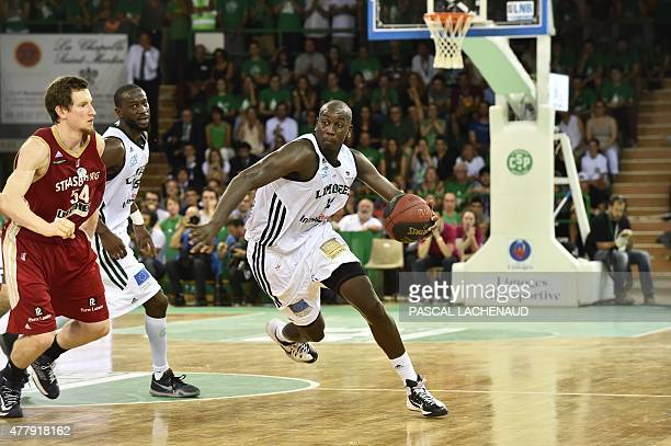 Limoges' Ousmane Camara controls the ball during the Pro A Basketball game 4 of the final against Strasbourg in Limoges on June 20 2015 AFP PHOTO /...