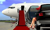 lady in red arrival with red carpet before boarding an airplane
