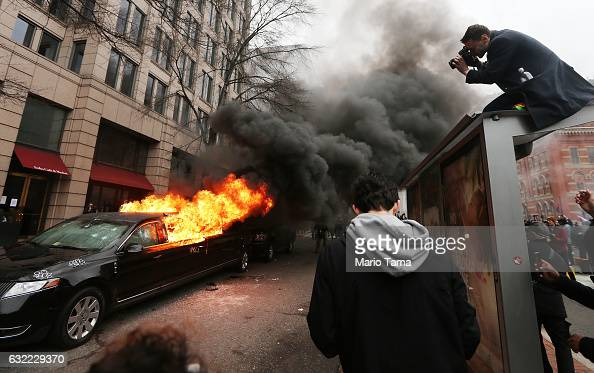 A limousine burns after being smashed by antiTrump protesters on K Street on January 20 2017 in Washington DC While protests were mostly peaceful...