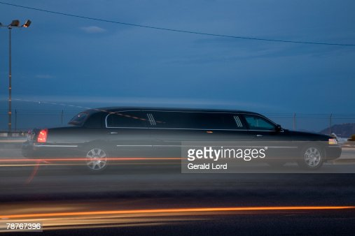 A limousine driving along the road