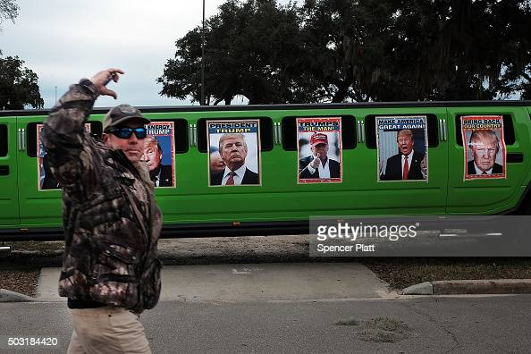 A limousine is decorated with pictures of Republican presidential frontrunner Donald Trump before he speaks at the Mississippi Coast Coliseum on...