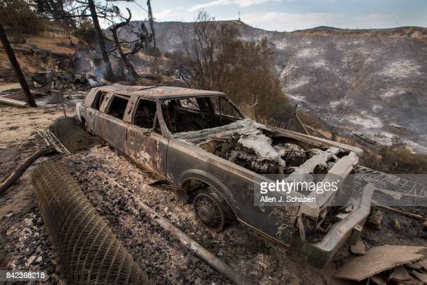 A limousine parked in front of a home and property lies in ruin as it was one of three homes and a shed were destroyed in the the La Tuna Canyon fire...