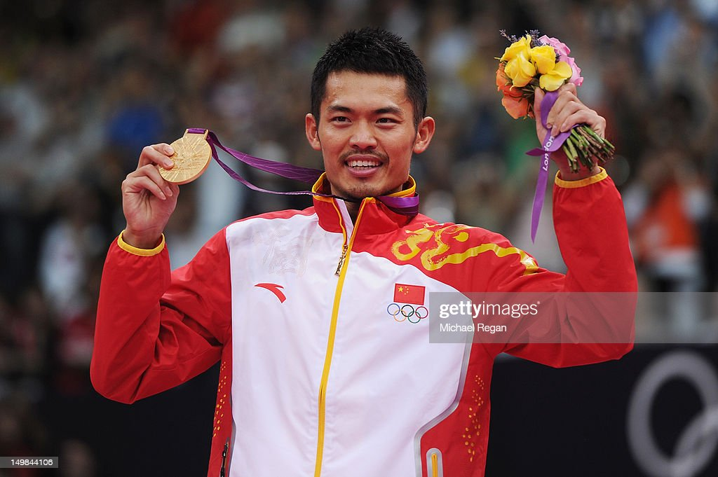 <a gi-track='captionPersonalityLinkClicked' href=/galleries/search?phrase=Lin+Dan+-+Badminton+Player&family=editorial&specificpeople=211013 ng-click='$event.stopPropagation()'>Lin Dan</a> of China celebrates with his Gold medal after winning his Men's Singles Badminton Gold Medal match against Chong Wei Lee of Malaysia on Day 9 of the London 2012 Olympic Games at Wembley Arena on August 5, 2012 in London, England.