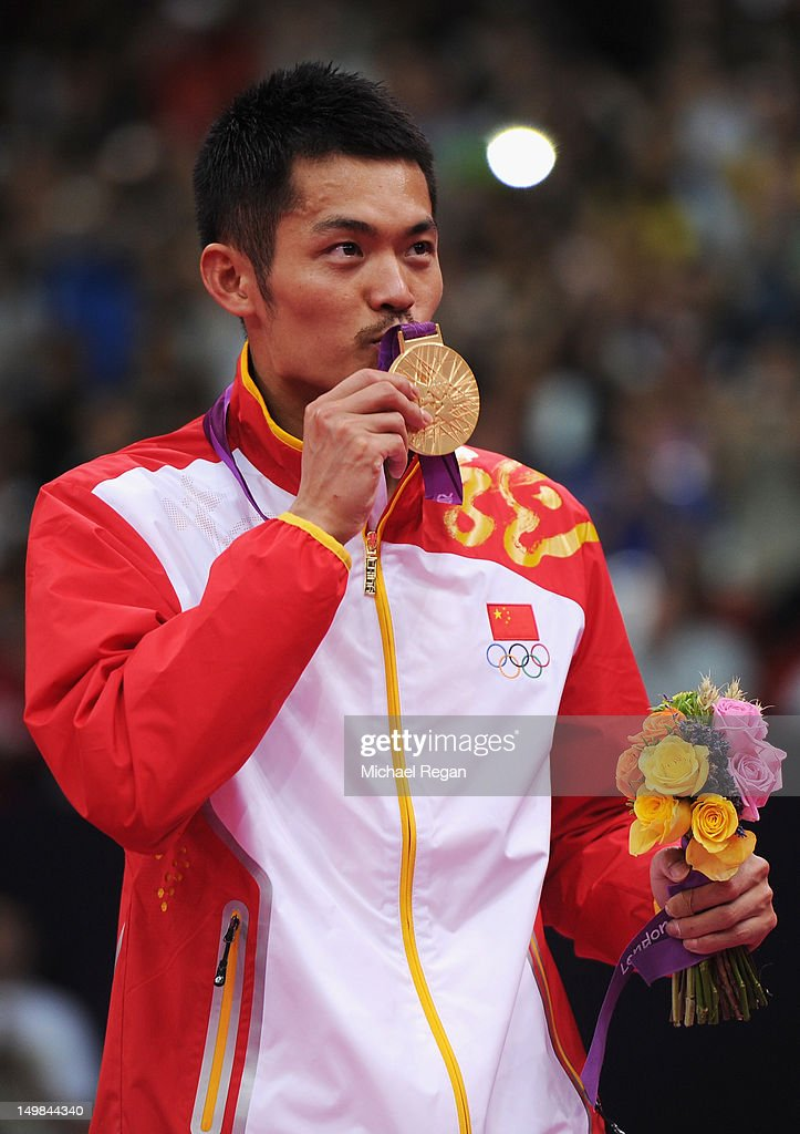 <a gi-track='captionPersonalityLinkClicked' href=/galleries/search?phrase=Lin+Dan&family=editorial&specificpeople=211013 ng-click='$event.stopPropagation()'>Lin Dan</a> of China celebrates with his Gold medal after winning his Men's Singles Badminton Gold Medal match against Chong Wei Lee of Malaysia on Day 9 of the London 2012 Olympic Games at Wembley Arena on August 5, 2012 in London, England.