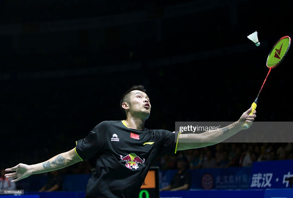 Lin Dan of China hits a return to Lee Chong Wei of Malaysia during their men's singles semi-final match at the 2016 Badminton Asia Championships in Wuhan, central China's Hubei province on April 30, 2016. / AFP / STR