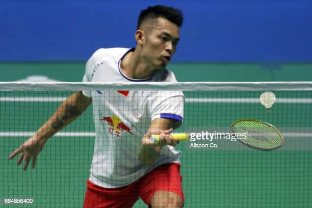 Lin Dan of China plays a return shot to Sai Praneeth of India in the men's singles during the preliminary round of the 2017 World BWF Super Series...