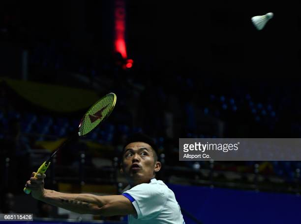 Lin Dan of China plays a return shot to Tanongsak Saensomboonsuk of Thailand during the preliminary round of the 2017 World BWF Super Series Malaysia...