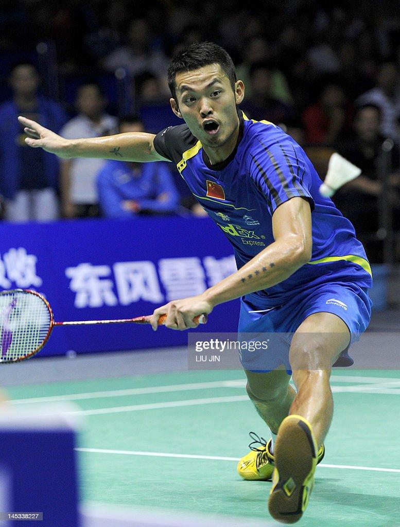 Lin Dan of China returns a shot against