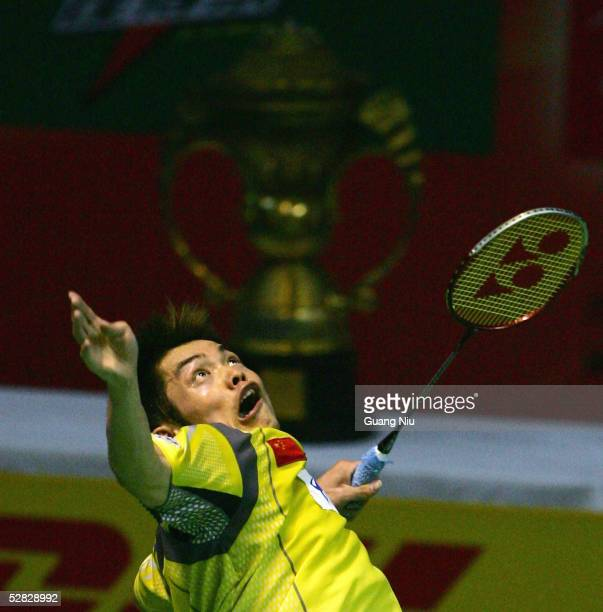 Lin Dan of China returns a shot in front of the trophy of the 2005 Sudirman Cup World Mixed Team Badminton Championships during the final match...