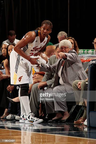 Lin Dunn head coach of the Indiana Fever speaks with Tamika Catchings of the the at Conseco Fieldhouse on July 9 2011 in Indianapolis Indiana NOTE TO...