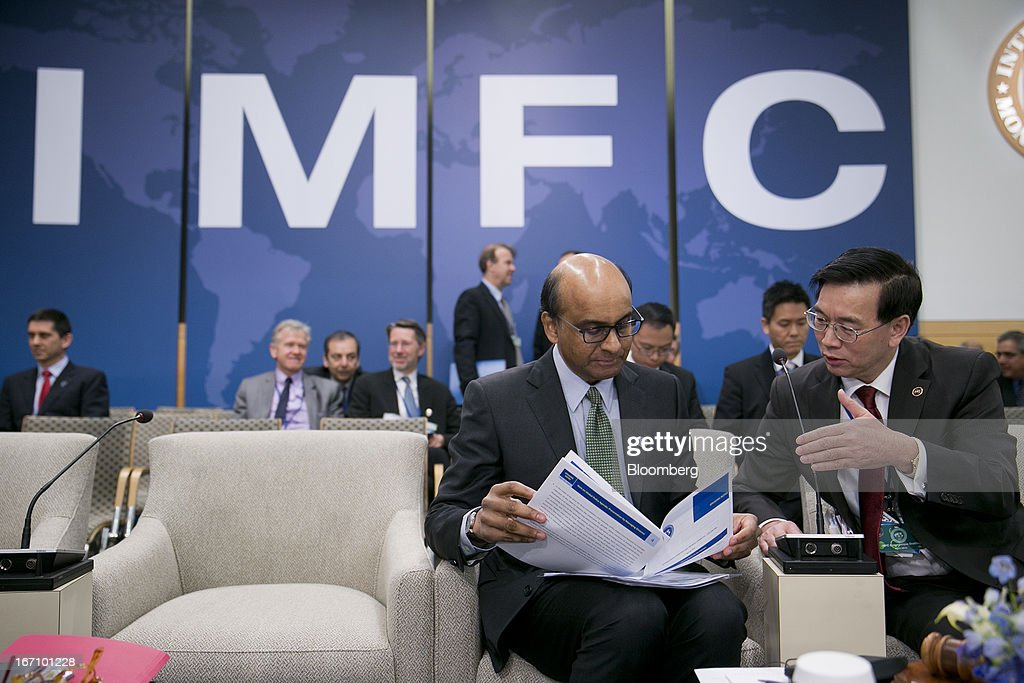 Lin Jianhai, secretary of the International Monetary and Financial Committee (IMFC), right, talks to Tharman Shanmugaratnam, Singapore's finance minister, at the IFMC meeting during the International Monetary Fund (IMF) and World Bank Group Spring Meetings in Washington, D.C., U.S., on Saturday, April 20, 2013. The IMF's Managing Director said the euro area has the only central bank with enough leeway to take more measures to boost growth as low interest rates fail to trickle down to the region's economy. Photographer: Andrew Harrer/Bloomberg via Getty Images