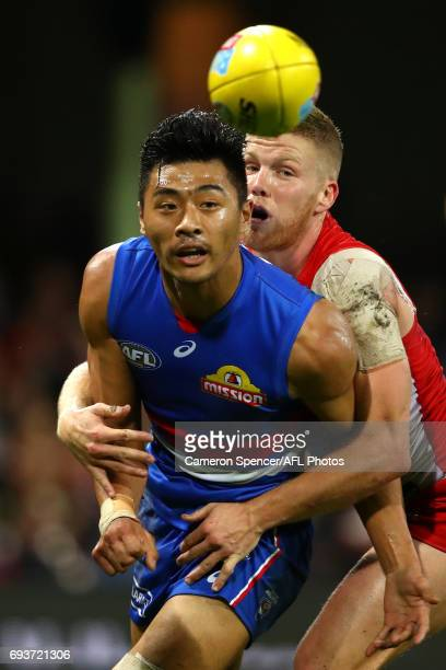Lin Jong of the Bulldogs is tackled by Dan Hannebery of the Swans during the round 12 AFL match between the Sydney Swans and the Western Bulldogs at...