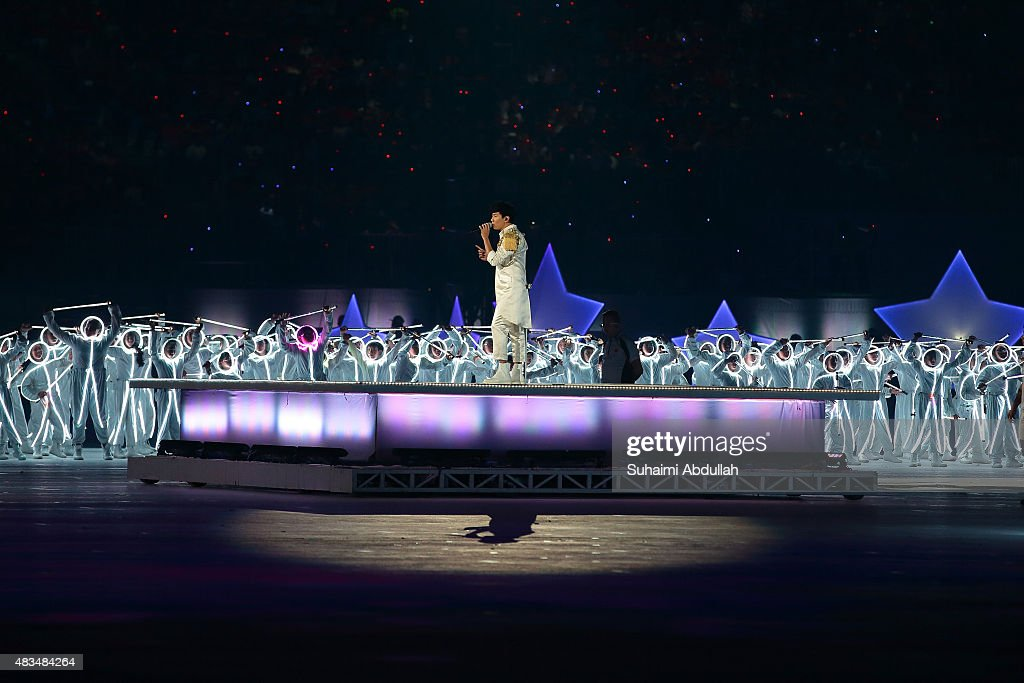<a gi-track='captionPersonalityLinkClicked' href=/galleries/search?phrase=JJ+Lin&family=editorial&specificpeople=3868242 ng-click='$event.stopPropagation()'>JJ Lin</a> sings on stage during the National Day Parade at Padang on August 9, 2015 in Singapore. Singapore is celebrating her 50th year of independence on August 9, 2015.