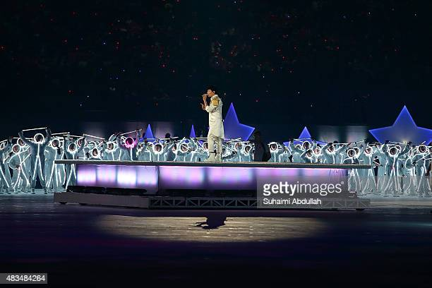 Lin sings on stage during the National Day Parade at Padang on August 9 2015 in Singapore Singapore is celebrating her 50th year of independence on...