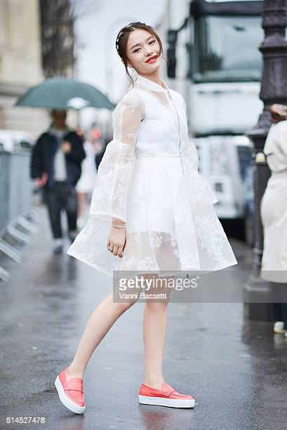 Lin Yun poses wearing Moncler before the Moncler Gamme Rouge show at the Grand Palais during Paris Fashion Week FW 16/17 on March 9 2016 in Paris...
