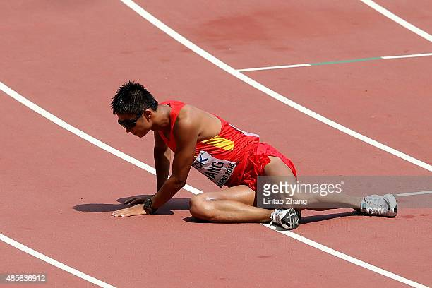Lin Zhang of China shows his exhaustion after crossing the finish line in the Men's 50km Race Walk final during day eight of the 15th IAAF World...
