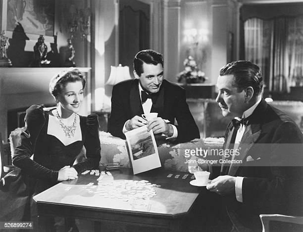 Lina Asygarth and Johnnie Asygarth talk with Beaky Thwaite in a publicity still for Suspicion