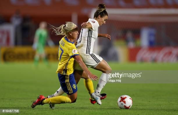Lina Magull of Germany and Caroline Seger of Sweden compete for the ball during the Group B match between Germany and Sweden during the UEFA Women's...