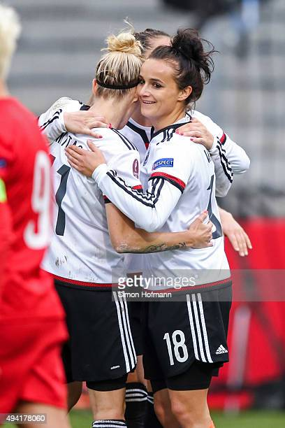 Lina Magull of Germany celebrates her team's fifth goal with her team mates during the UEFA Women's Euro 2017 Qualifier match between Germany and...