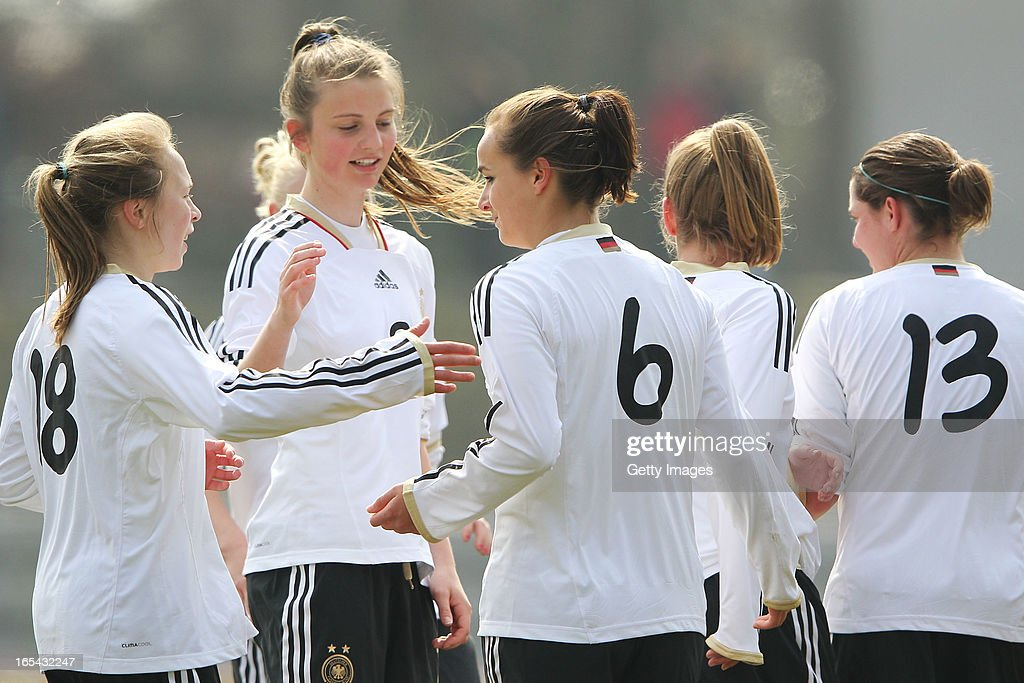 Lina Magull of Germany (C) celebrates her team's second goal with team mates during the Women's UEFA U19 Euro Qualification match between U19 Germany and U19 Spain at Waldstadion in Viernheim on April 4, 2013 in Viernheim, Germany.