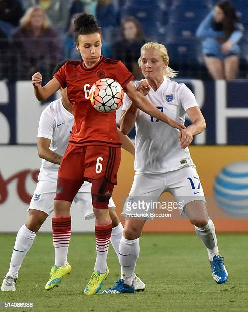 Lina Magull of Germany chests the ball down in front of Katie Chapman of England during the second half of a friendly international match in the...