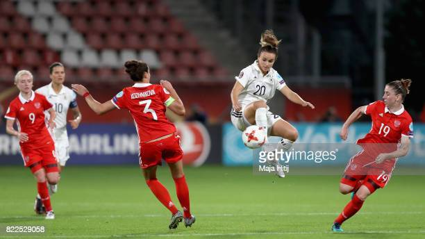 Lina Magull of Germany controls the ball while under pressure from Anna Kozhnikova of Russia and Ekaterina Morozova of Russia during the Group B...