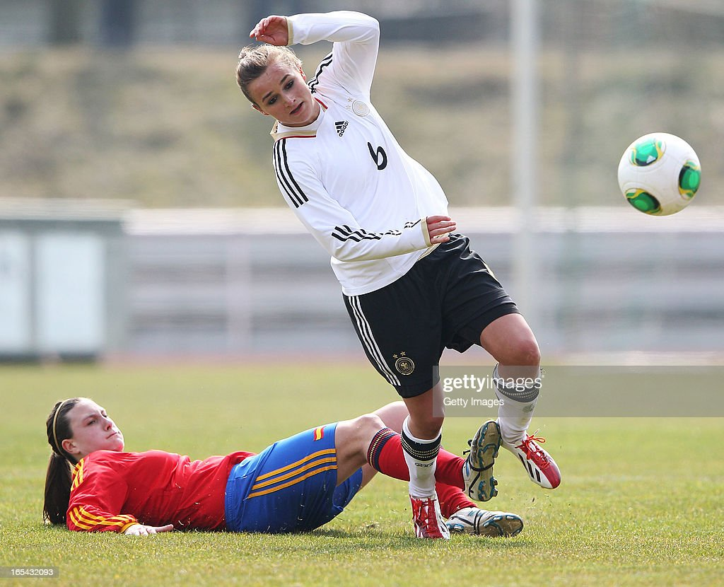 Lina Magull of Germany is challenged by Gema Gili Giner of Spain during the Women's UEFA U19 Euro Qualification match between U19 Germany and U19 Spain at Waldstadion in Viernheim on April 4, 2013 in Viernheim, Germany.