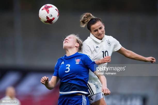 Lina Magull of Germany jumps for a header with Birna Mikkelsen Tummasardottir of Faroe Islands during the 2019 FIFA Women's World Championship...