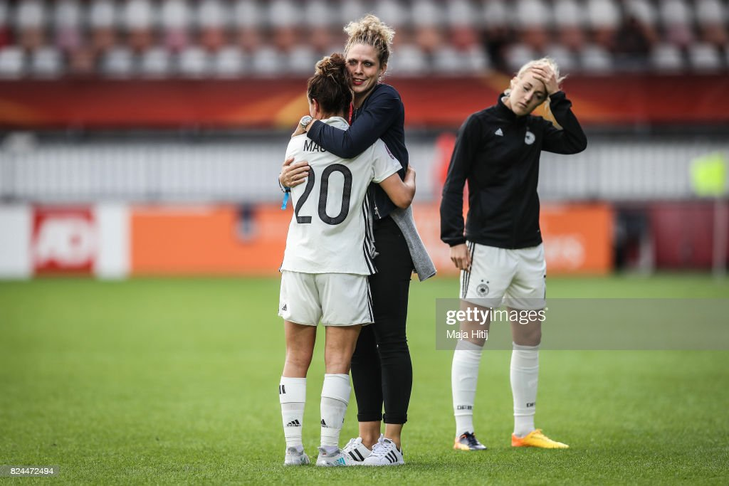 Lina Magull of Germany, Kim Kulig and Carolin Simon react after the UEFA Women's Euro 2017 Quarter Final match between Germany and Denmark at Sparta Stadion on July 30, 2017 in Rotterdam, Netherlands.