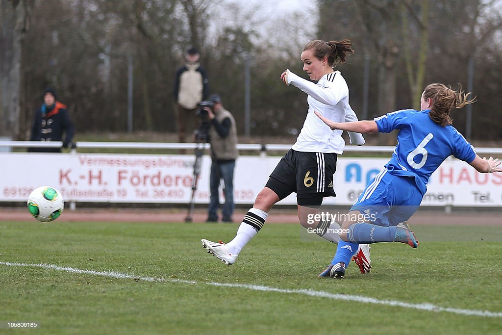 Lina Magull of Germany scores their fourth goal Lamprinitsa Lymperakaki of Greece during the Women's UEFA U19 Euro Qualification match between U19 Germany and U19 Greece at Sportzentrum Sued against on April 6, 2013 in Kirchheim, Germany.