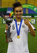Lina Magull poses after winning the FIFA U20 Women's World Cup Canada 2014 final match between Nigeria and Germany at Olympic Stadium on August 24...