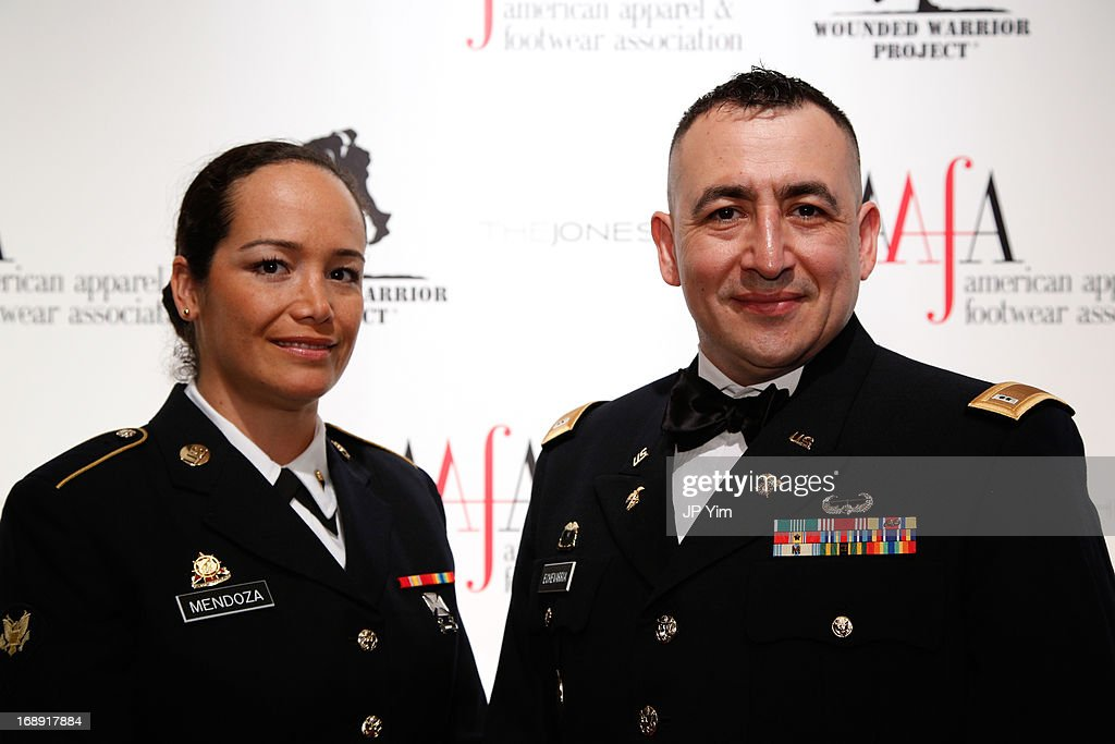 Lina Mendoza and Raul Echevarria from the 369th Sustainment Brigade 'Harlem Hellfighters' attend the 35th Annual American Image Awards at the Intrepid Sea-Air-Space Museum on May 16, 2013 in New York City.