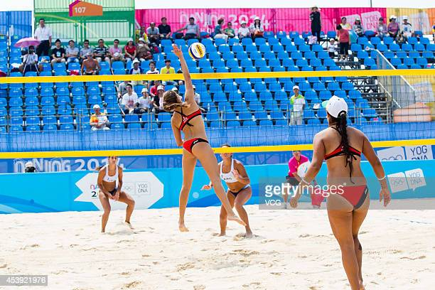 Lina Mercedes Bernier Colon and Valeria Alexandra Cajigas Medina of Puerto Rico compete with players of Argentina in the Women's Beach Volleyball...