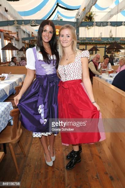 Lina Meyer girlfriend of FC Bayern soccer player Josua Kimmich and Elena Rudy wife of FC Bayern soccer player Sebastian Rudy wearing a dirndl by...