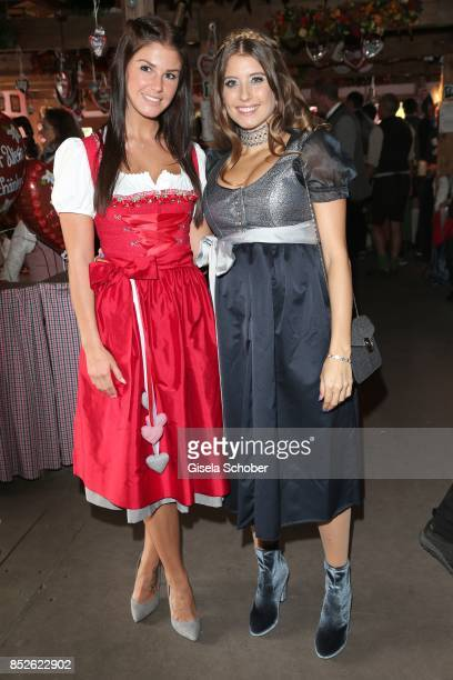 Lina Meyer wearing a dirndl by Schatzi Dirndl and Cathy Hummels wearing a dirndl by her own collection by Angermaier Trachten during the 'FC Bayern...