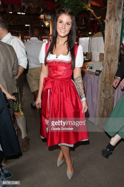 Lina Meyer wearing a red dirndl by Schatzi Dirndl during the 'FC Bayern Wies'n' as part of the Oktoberfest at Theresienwiese on September 23 2017 in...