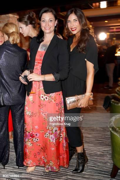 Lina van de Mars and Alexandra Polzin attend the Annabelle Mandeng Hosts Ladies Dinner In Berlin on July 2 2017 in Berlin Germany
