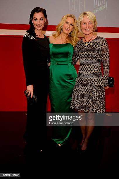 Lina van de Mars Barbara Schoeneberger and Isolde Holderied attend 'Goldenes Lenkrad' Award 2014 at Axel Springer Haus on November 11 2014 in Berlin...